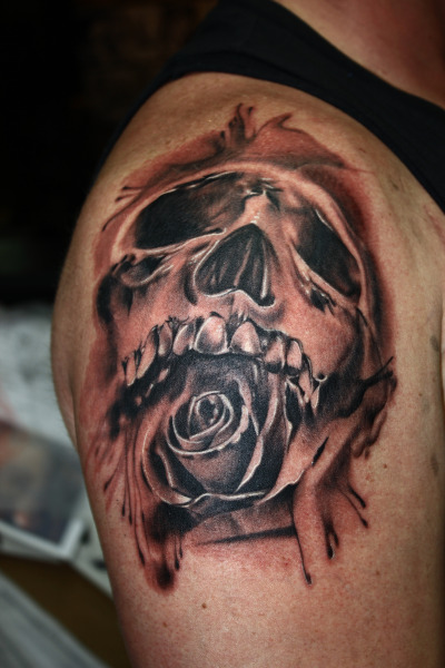 Did this tattoo as a result of a painting the customer brought in he wanted referenced and I put my own painterly spin to it.  Tried to capture the true essence of life and death with a skull and rose.  Ultimately what we all end up with when we die.  Done by Aaron Riddle of Tainted Skin in Crown Point, Indiana.