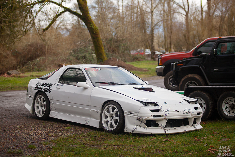 I instantly fell in love with this car. Carbureted V8 in a FC RX7… :)