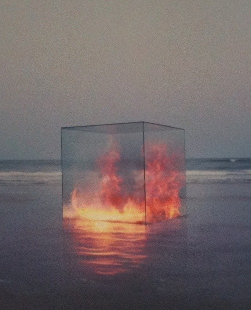 Fire in a box on a beach