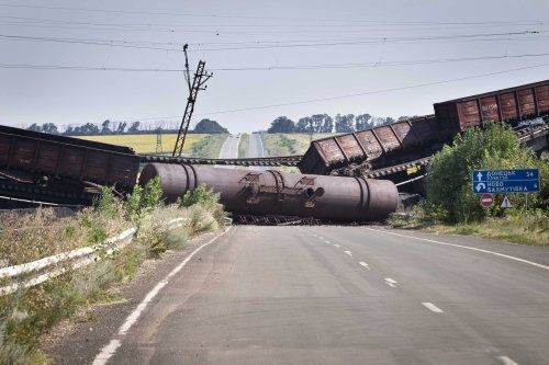 A train and a railroad bridge that had been blown up blocked a road between Donetsk and Kharkiv in eastern Ukraine on Monday.Evert-Jan Daniels
