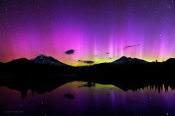 "ikenbot:  Ambitious Dreams ""A rare strong aurora appearance over central Oregon's Sparks Lake illuminating the distant mountain peaks of South Sister and Broken Top."" — Brad Goldpaint"