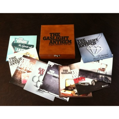 "The Gaslight Anthem 2008-2011 Singles Collection Box Set- . Gaslight Anthem Singles Collection 2008-2011 on Limited Edition 9 x 7"" Box Set + Download Card + 45 RPM Adaptor + Limited Edition wood box  . Featuring Singles, Rare Acoustic Tracks, & Live Cuts Across Nine 7"" Vinyl Discs Cut at 45RPM!  . Singles Collection: 2008-2011 includes nine 7"" vinyl discs cut at 45 rpm featuring the Gaslight Anthem's singles from that era plus rare acoustic and live tracks, a download card and a 45 RPM adapter, all packaged in a limited edition wooden collector's chest! . The Gaslight Anthem Singles Collection 2008-2011 Track Listing: . #1. The '59 Sound 7"" A1. The '59 Sound  B1. State of Love and Trust (Live at Webster Hall)  . #2 Old White Lincoln 7"" A1. Old White Lincoln  B1. The '59 Sound (Acoustic on KEXP)  . #3 Great Expectations 7"" A1. Great Expectations  B1. Great Expectations (Acoustic on KEXP)  . #4 American Slang 7"" A1. American Slang  B1. American Slang (Acoustic)  . #5 Boxer 7"" A1. Boxer  B1. Boxer Acoustic  . #6 The Diamond Church Street Choir 7""  A1. The Diamond Church Street Choir  B1. Antonia Jane (acoustic on KEXP)  . #7 Stay Lucky 7"" A1. Stay Lucky  B1. Tumbling Dice  . #8 The Spirit of Jazz 7""  A1. The Spirit of Jazz  B1. The Queen of Lower Chelsea (acoustic)  . #9 B-Sides 7"" A1. Once Upon a Time  B1. She Loves You  . Pre-Order Here: http://www.musicdirect.com/p-129334-gaslight-anthem-singles-collection-limited-edition-9-x-7-box-set.aspx  . or here: http://www.shopradiocast.com/products/Gaslight-Anthem-%252d-Singles-Collection%3A-2008%252d2011-9x7%22-Boxset.html  ."