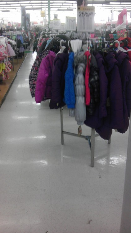 I'd like to push my cart through, but there's nothing but ugly-ass coats on clearance blocking the way! Really, look at that gap between the clothing department and that rack.