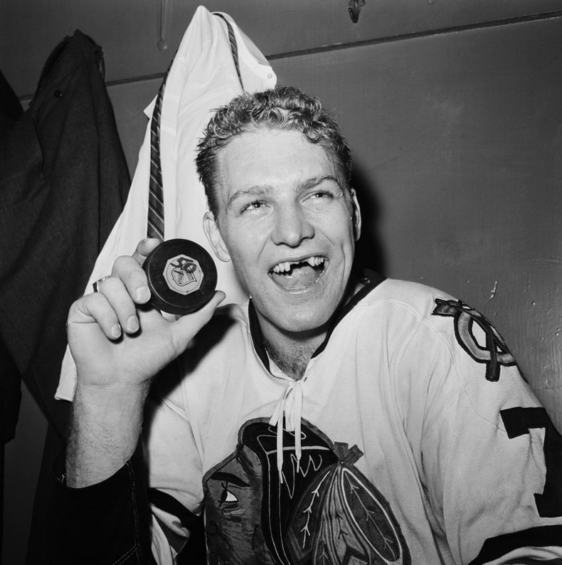 I like to think that Bobby Hull will remove his dental prosthetics before he blows out all seventy-four candles today.