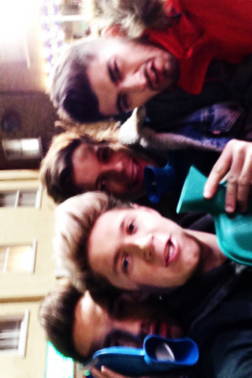 @NiallOfficial: Haha found this on my phone! From the midnight memories video shoot, it was freezing , think Harry was in the toilet