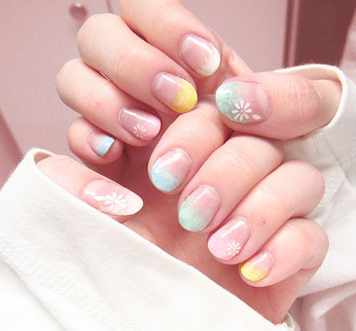nailpornography:   Pastel fade nails w/ white decal flowers. :)  submitted by kuthinks like these nails? GO VOTE