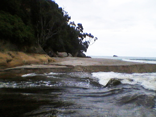 River meets beach meets ocean. Whiritoa beach after the drought broke.