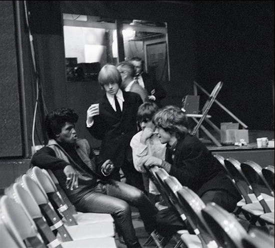 thacurve-r-n-b:  rock-and-roll-will-never—die:  James Brown, Brian Jones, Keith Richards, Mick Jagger The body language in this picture is priceless.