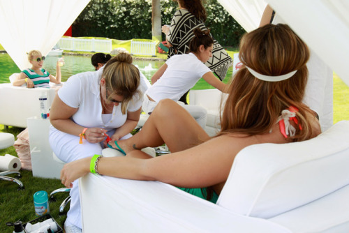 At its Coachella party, Lacoste set up a nail art station, where guests could stop by for colorful, branded looks applied in a breezy white cabana. Photo: Joe Scarnici/Getty Images for Lacoste - See more HERE.