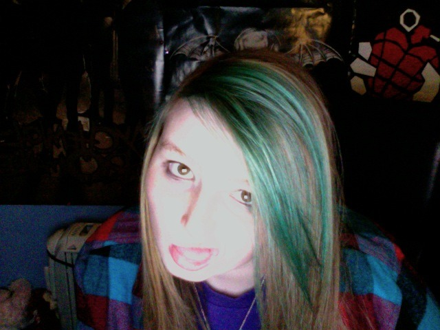 That one time so many years ago when I tried to dye my hair turquoise the night before a Green Day concert in NYC and it turned out green. I'd say i'm probably fourteen here.