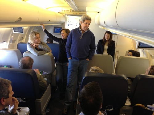 U.S. Secretary of State John Kerry speaks with the traveling press corps aboard U.S. Air Force Boeing 757 en route to London, the United Kingdom, February 24, 2013. [State Department photo/ Public Domain]