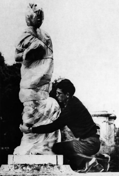 Christo wrapping one of the sculptures in the garden of the Villa Borghese, Rome, 1963