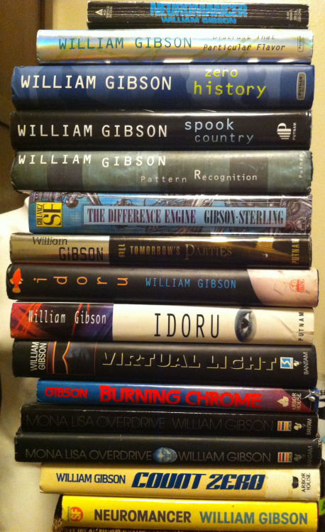 My favorite part of my book collection; my William Gibson first editions. The copy of Neuromancer is the UK first edition; still need to get my hands on the American edition. At the top of the pile is the first edition paperback of Neuromancer which was released in America in '84, two years before the hardcover first edition. The second copy of Mona Lisa Overdrive is the unedited proof copy; which is something usually put together for editors and for the purpose of advertising/trying to create buzz for the books release. The copy of Idoru with the black spine is the UK first edition. My copy of The Difference Engine is from the UK as well. I just really like the UK editions; I often prefer their cover art.
