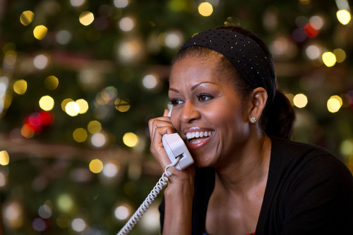 REMARKS BY THE FIRST LADY TO CHILDREN ON THE NORAD SANTA TRACKER CALL Via Telephone MRS. OBAMA: Hi, Lilli! LILLIANA: Hi. MRS. OBAMA: How old are you, Lilli? LILLIANA: Huh? MRS. OBAMA: How old are you? LILLIANA: Eleven. MRS. OBAMA: Eleven, yeah. You sound like the mature one in the group. LILLIANA: No. (Laughter.) MRS. OBAMA: Okay, what's your question? LILLIANA: I saw the TV show when everybody was decorating the White House. About how many Christmas trees do you think that there are around the whole White House? MRS. OBAMA: Around the entire White House we have 54 Christmas trees this year. LILLIANA: Wow. MRS. OBAMA: A lot, yeah. We had a lot of Christmas trees. And it's a pretty big house, and they have trees in every part of the White House. There is a tree in the Oval Office where the President works. And there's trees outlining all the entrances of the White House. So we have a lot of trees, so it's very exciting. One day you have to come and visit us during the Christmas holidays because the house is really pretty. You think you could do that one year? MRS. THOMAS: She would love—yes, she would love that. ABIGAIL: I would, too! MRS. OBAMA: Well, you all should come. So do you want to know where Santa is? Because I'm working with—I'm looking at the satellite right now and they told me that when they last spotted Santa he was over Italy. So now he's in Europe, in Italy. And he's going to be in Palermo for a few seconds, but then he's heading to Naples, Italy. And right now, according to my sources, he's delivered more than 3 billion gifts already. Can you believe that? ABIGAIL: Wow! I looked at it and the numbers were rising like every millisecond. MRS. OBAMA: They are moving so fast. It's amazing, but that's how fast Santa Claus is. I mean, it's like magic what he can do. Well, you know what, guys, I hope you all have a very merry Christmas, okay? Because I can tell you guys have been good this year, haven't you? MRS. THOMAS: They try. (Laughter.) MRS. OBAMA: Trying counts, right? MRS. THOMAS: Yes, it does. MRS. OBAMA: Trying counts. LILLIANA: Thank you for taking the time to talk to us. Bye! MRS. OBAMA: Oh, it was great talking to you guys. Try to get to bed early, okay? I know it's hard, but try to close your eyes and get some rest. LILLIANA: Okay, thank you! MRS. OBAMA: All right, you guys have a merry Christmas. It was great talking to you. CHILDREN: And a happy new year! (Laughter.)