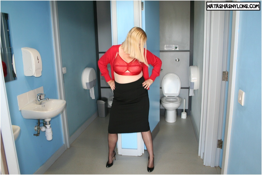 natashanylons:  more of me in the public toilets in bullet bra and black stockings