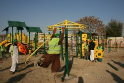Here, have an 'adults doing kid stuff is awesome' - Kabul workers on a playground.  via Play by Design