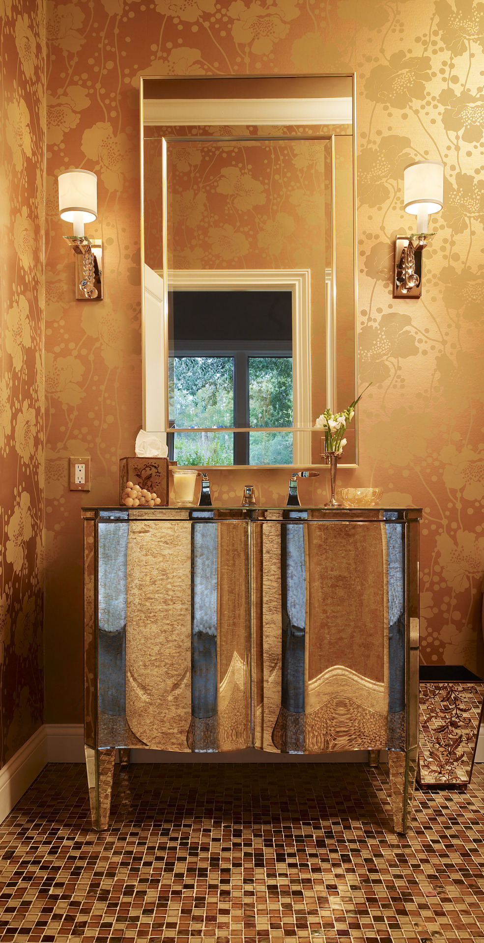 We went for glamour when we designed this powder room with the use of reflective surfaces