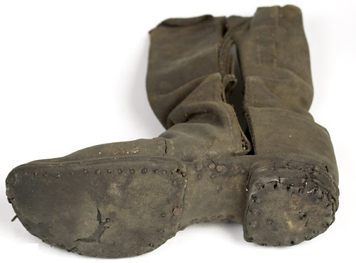 thecivilwarparlor:  A Soldier's Boot from Gettysburg- They were so valuable they were even pulled from the feet of dead men on the bloodstained battlefields and were used by prisoners to barter for supplies such as food or tobacco.  If the Union or Confederate soldier was not a horse-mounted cavalryman or officer, he was a foot soldier. Throughout the war, they marched long and hard, sometimes up to 30 or 40 miles a day. As a result, shoes became sorely needed by both sides. There are many accounts of Rebels marching for miles barefoot during the winter. Often, Rebel foot soldiers with no shoes or poorly fitted ones were organized into separate commands to march apart from the rest of the troops on the soft grassy roadsides. Photo Credit Cowan's Auctions. sold for 805.00$