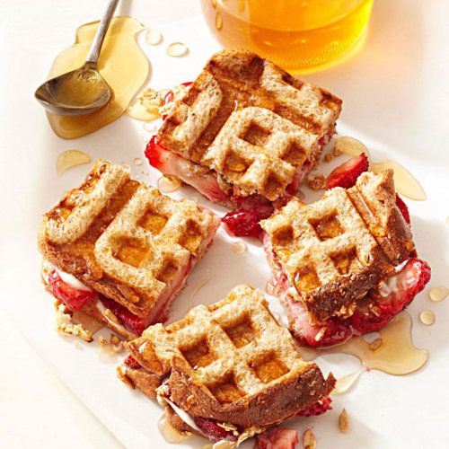 Strawberries & Cream Cheese Waffle Sandwiches: Start off the morning with this healthy breakfast including whole grains and low-fat granola.