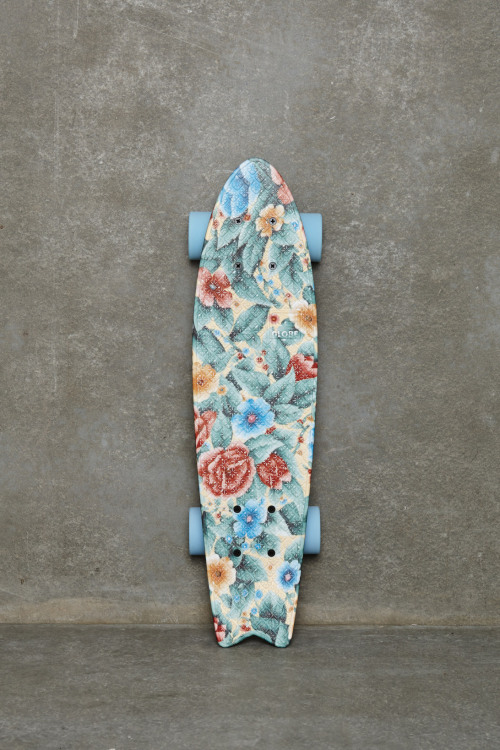 My dad has a skateboard in the shape that he painted flowers on. They're pretty bad flowers, but he painted them so I'm proud~