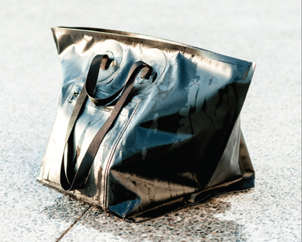Say goodbye to toting around soppy wetsuit bags—this Baggu all-weather vinyl gearbag comes with leakproof zippers and welded seams for easy transportation!