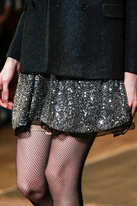 Masculine black blazer over feminine golden sequin dress. Luxus Punk Fashion Trend for Fall Winter 2013. Saint Laurent  Fall Winter 2013. More Punk Styles Fashion Trends for Fall Winter 2013. More Sequin Dress Fashion Trend for Fall Winter 2013. More Golden Color Fashion Color Trend for Fall Winter 2013. More Masculine Feminine Fashion Trends for Fall Winter 2013. May 20th, 2013 10:26  P.M. GMT.