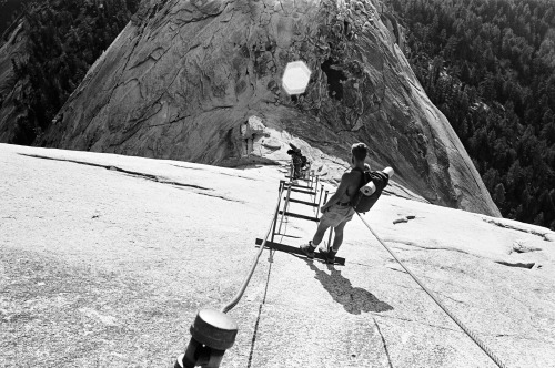 patagonia:  Roger McDivitt on Half Dome cables. Circa 1975.  Photo by Carry Regester.