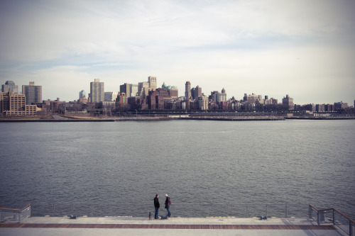 Date. On a pier in the Financial District, Manhattan, NYC in February 2012. Brooklyn Heights can be seen on the other side of East River.