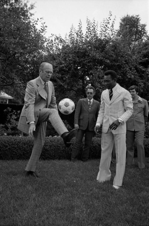 awesomepeoplehangingouttogether:  Gerald R. Ford and Pelé  I did not expect the sitting (?) president to have the more ridiculous suit than the professional athlete, but there are you are. That's the '70s for you.