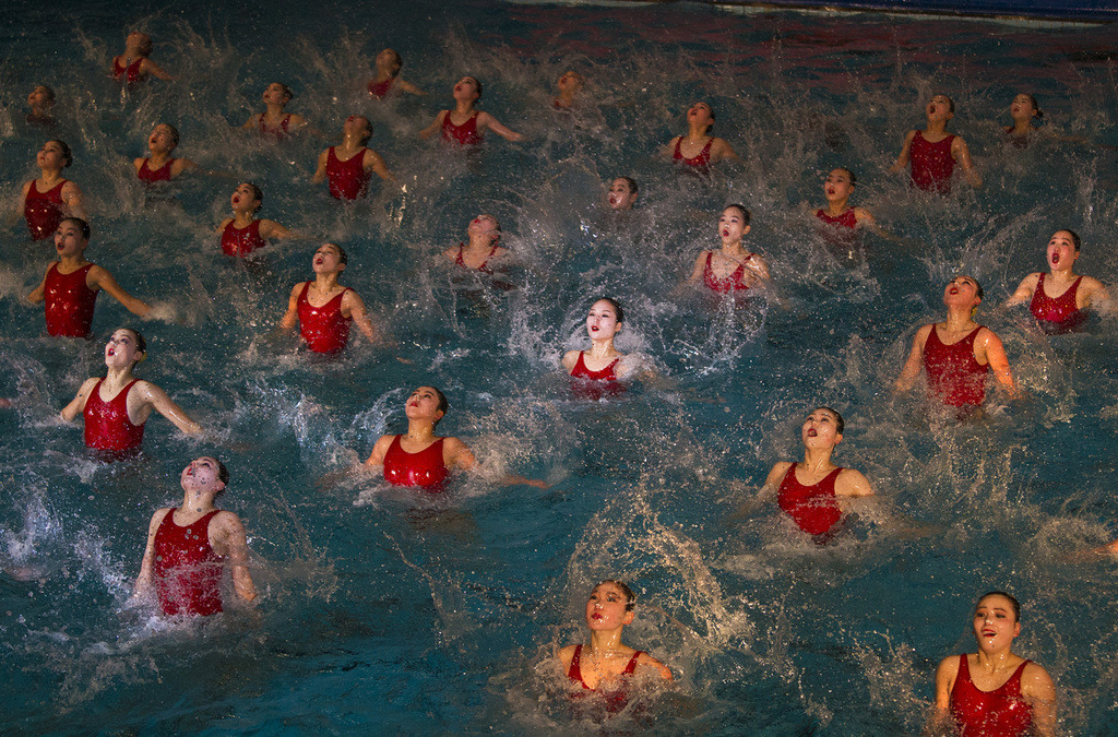 Photo by David Guttenfelder.  North Korean women perform in a mass synchronized swimming show in Pyongyang, North Korea to celebrate the birthday of the late leader Kim Jong Il, who would have turned 70 on February 16, 2012. February 15, 2012.