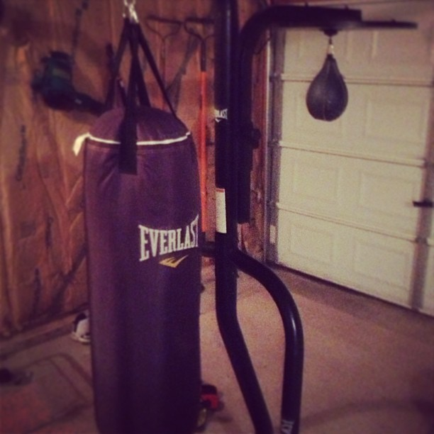 This right here is my #HappyPlace. This is my #zone & my #dojo. It's where I come to #workout my problems & to think. & it's the only thing that keeps me from curb stomping dumb motherfuckers on the regular. Lbvs.  #everlast #boxing #kickboxing #muaythai #homegym #garage