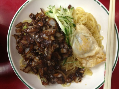"간짜장 ""Gan Jja Jang"" — Essentially it's Jjajangmyun (""Chinese"" black bean noodles) but the sauce is panfried and a fried egg and a bit of freshly sliced cucumber is added into the mix."