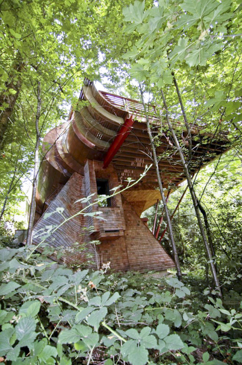 "architizer:  Finally, a Treehouse for Adults! ""It seems almost inexplicable that a house with such bold forms and so dramatic cantilevers could remain even remotely anonymous, yet, as the shadows of leaves cast dappled light over the weathering copper, as the curving lines of the shingles begin to resemble the grains of sawn timber, and glass throws back images of the surrounding forest, it becomes completely obvious that this building is at peace with its environment."" Click through to read more!"