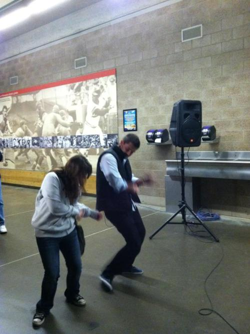 Drew Butera shows a fan how to dougie.