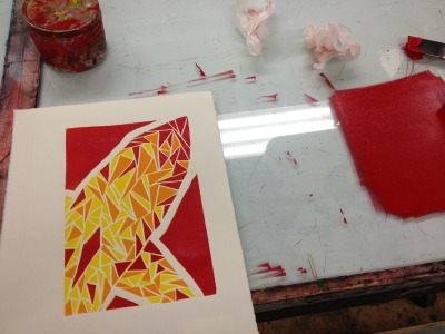 Third (and last) color pass of a reductive linocut print. Red definitely got a little messy at the end.