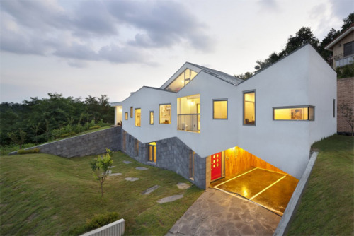 Architect Moon Hoon recently designed the Panorama House in Chungcheongbuk-do, South Korea. One of the most unique features incorporated into the home is a wooden slide built directly into a library which also functions as a stair-stepped home theater seating area.  Library Slide by http://www.moonhoon.com/