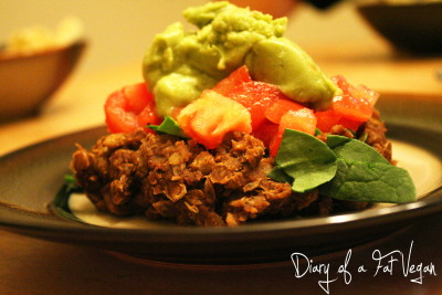 monday dinner- lentil taco salad. seasoned lentils with spinach, tomato, and guacamole