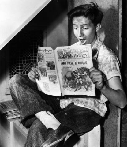 Denver on February 23, 1947:  Bob Huff reads a dime novel, titled Fancy Frank of Colorado in the Western History department of the Denver Public Library. DPL's Western History Collection opened to the public in 1935. Today, it's one of the world's leading research centers for Colorado history and the history of the American West (and it's also where a lot of the images on this Tumblr come from). Go visit. The people who work there are great, and they want to help you.  (Photo via Denver Public Library Western History Collection)