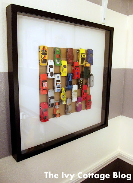 DIY Cheap and Easy Matchbox Car Wall Art Tutorial from The Ivy Cottage Blog here. Shadow box frames are so cheap everywhere now.