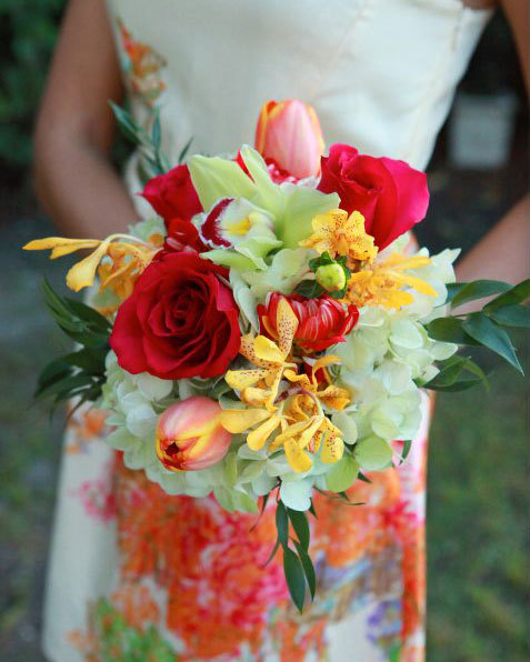Lovely contrasting colors to accent the patterned bridesmaid dresses for an outdoor wedding.  A garden-style bouquet with roses, tulips, and orchid sprays, collared by green hydrangea blossoms. Image by Castaldo Studio
