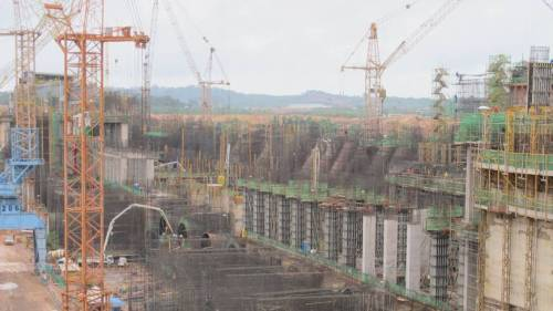 Above, the gigantic Jirau Dam is one of 34(!) hydroelectric dams being built in the Amazon by Brazil. Thousands of people and dozens of communities and towns will be flooded by the dams. Meanwhile, environmentalists are left out of negotiations.  When it is completed in 2015, the Jirau hydroelectric dam will span the Madeira River, feature more giant turbines than any other dam in the world and hold as much concrete as 47 towers the size of New York's Empire State Building. And then there are the power lines, draped along 2,200 km of forests and fields to carry electricity from the middle of South America to Brazil's urban nerve center, Sao Paulo.  Still, it won't be enough. The Jirau Dam and the Santo Antonio complex that is being built a few kilometers downstream will provide just 5 percent of what government energy planners say Brazil will need in the next 10 years.  So the country is building more dams, many more, courting controversy by locating the vast majority of them in the world's largest and most biodiverse forest. Excellent coverage by the Japan Times