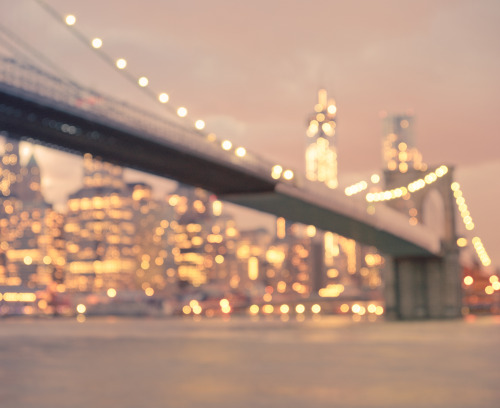 "New York City Skyline and the Brooklyn Bridge. Night lights bokeh. If you stop to squint long enough   all the dreams whispered on the wind during the day  flicker like fireflies when the evening  stretches out across the sky  and the rain washes the city's despair away  so it can dream itself into another sunrise.  —-This was taken on earlier this evening with the Sony A99 overlooking the New York City skyline and the Brooklyn Bridge in Brooklyn. I was taking long exposures earlier this evening and as the sky filled with enormous clouds shortly after sunset as the city's lights sprinkled themselves like glitter all over the evening cityscape and it was as if everything else melted away.   These are the moments I want to bottle up and save for later. And that's why I absolutely love photography.    —-View this photo with a comment thread on my Google Plus page—-View ""Brooklyn Bridge at Night - New York City"" in my photography portfolio here, email me, or ask for help."
