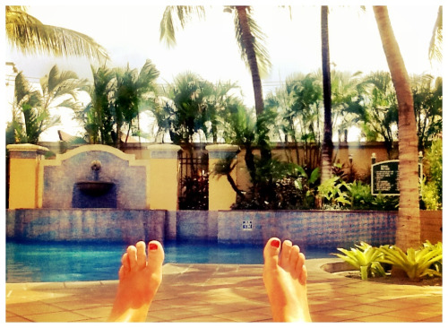 Poolside in Managua. Back to reality, sort of.