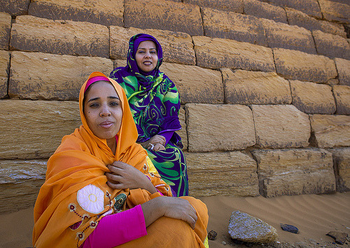 ae5alid:  Sudanese Women In Front Of The Pyramids And Tombs In Royal Cemetery, Meroe, Sudan  Poem for a gal from sudan http://www.youtube.com/watch?v=Q8cMJD-wWvM