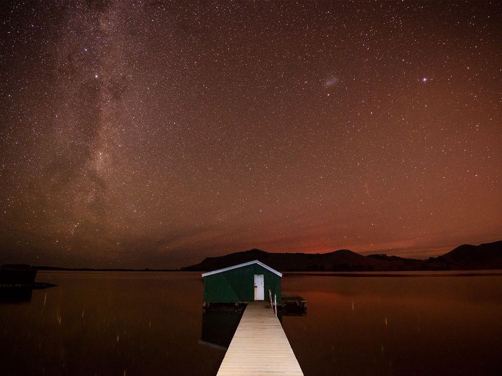 nationalgeographicdaily:  Milky Way, New ZealandPhoto: Stefan Mutch This was taken on the Otago Peninsula near Dunedin, New Zealand. I was hoping to capture some aurora activity. There was no aurora that night, but there was high humidity, so the light from the city was reflected over the entire sky, even though we were well away from the city. Instead of the usual gold or orange glow, the sky took on a red hue that was clearly visible to the naked eye.  Wow.