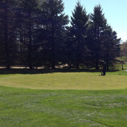 Greg setting new holes on the putting green at the Farm. (at Cammack Farm)