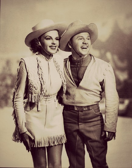 "dontsitundertheappletree:  Judy Garland and Mickey Rooney.  So I'm definitely laughing hysterically over the fact that I've recently come to the realization that not only am I Judy Garland's exact height…..but Kimmy is Mickey Rooney's height. (Judy must have heels on here.) Therefore….Kimmy *is* Mickey Rooney. X-D (No no, this has been a running joke for a few weeks ever since I found this info out. Needless to say, she's not impressed. Every time she sees a picture of Mickey and Judy, she gets all pouty and is like ""aw MAN, I'm THAT guy?"" LMAO)"
