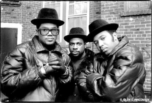 "themusicsnobs:  Pop stars. Run-DMC's landmark cover of Aerosmith's ""Walk This Way"" peaked at Number 5 on the Billboard Pop chart in 1986, and revived Aerosmith's career in the process. While it wasn't the best song from Raising Hell (""Peter Piper"" or ""My Adidas"", your pick), it didn't matter: the course of hip-hop was changed. -at"