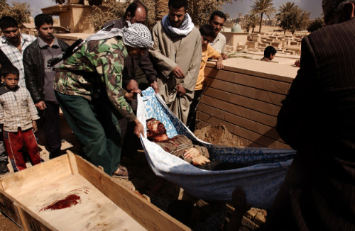 The burial of Fedayn, who was killed during a U.S. air strike, is held at the Baratha cemetery in Baghdad, Iraq, on April 1, 2003. Franco Pagetti/VII
