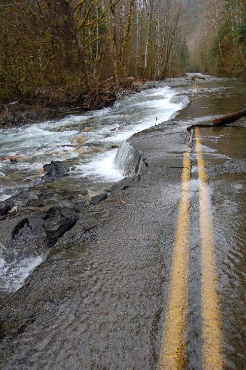 destroyed-and-abandoned:  Road washed out by flood, WA state.  This looks awesome.